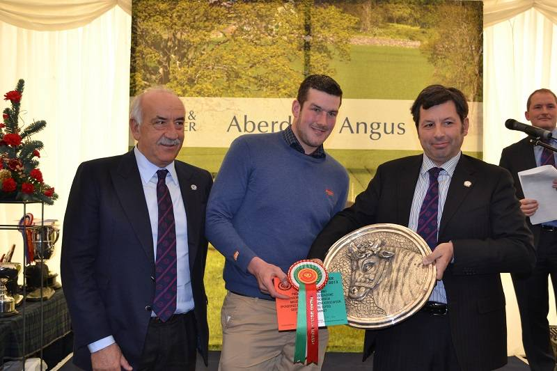 James Young accepting the Italian prize and 500 Euros which he also won with his Champion Young Producers animal