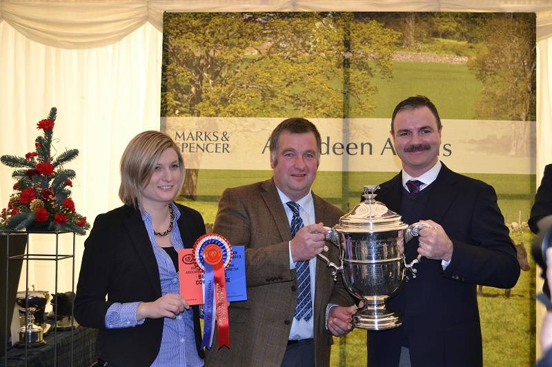John Emslie taking the Champion Cow trophy